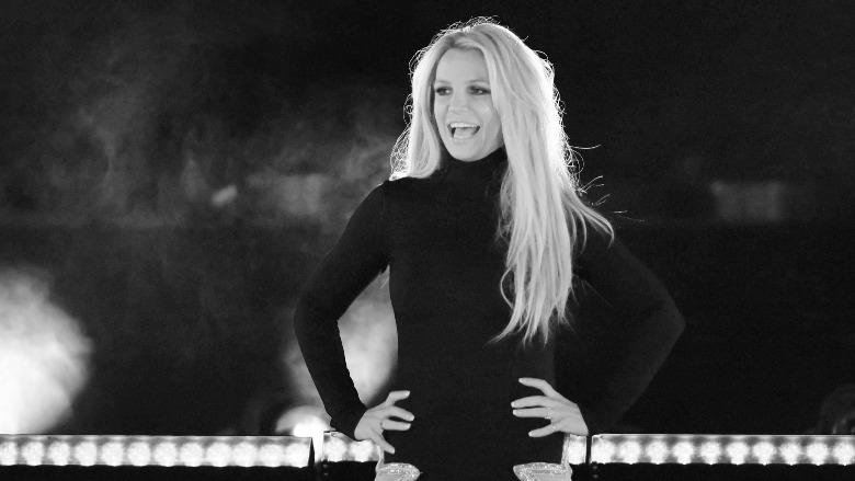 Britney Spears wearing a black dress.
