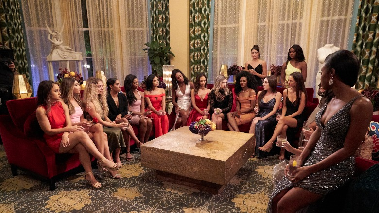 The cast of 'The Bachelor' sits on couches before the rose ceremony.