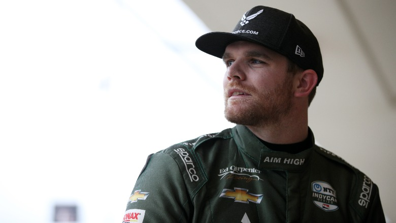 Conor Daly wearing a baseball cap.