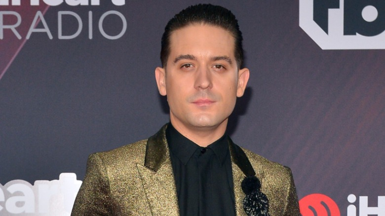 G Eazy poses on the red carpet.