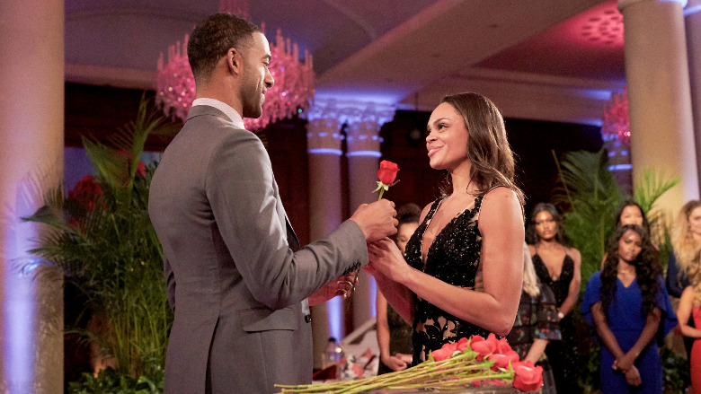 Matt James gives Michelle Young a rose.