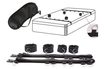 Black bondage straps on a mattress