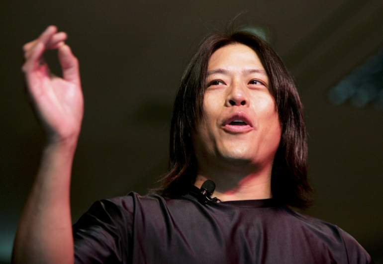 """Garrett Wang, who played the character Harry Kim on the television series """"Star Trek: Voyager,"""" jokes around as he speaks at the Star Trek convention at the Las Vegas Hilton August 12, 2005 in Las Vegas, Nevada."""