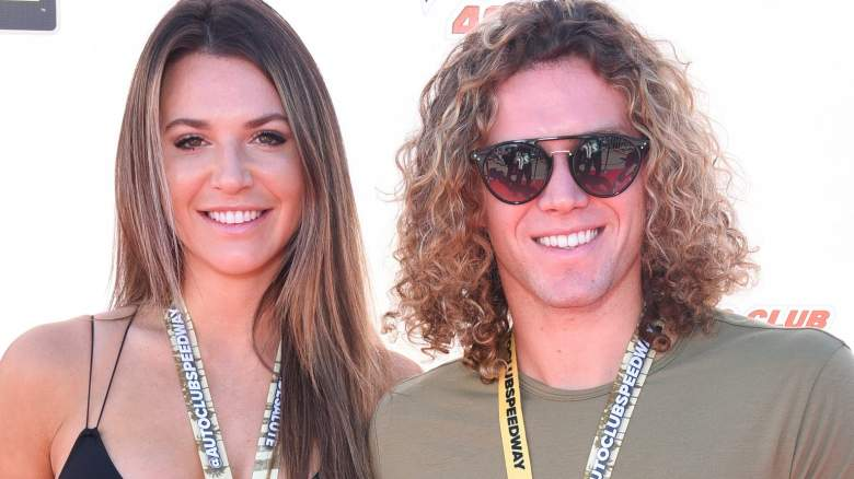 Angela Rummans and Tyler Crispen attend the Monster Energy NASCAR Cup Series race