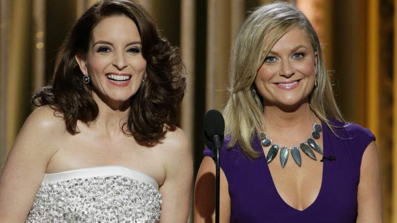 Hosts Tina Fey and Amy Poehler speak onstage during the 72nd Annual Golden Globe Awards