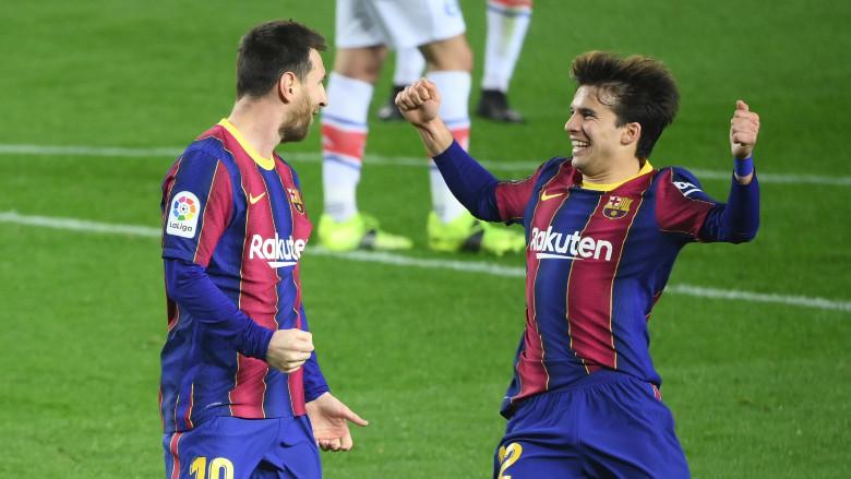 Lionel Messi and Riqui Puig