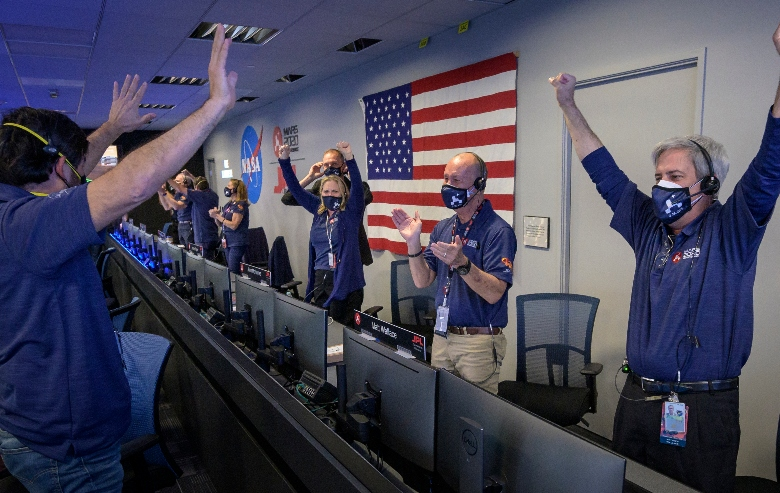 Members of NASA's Perseverance rover team react in mission control after receiving confirmation the spacecraft successfully touched down on Mars