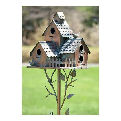 Metal bird house with multiple openings