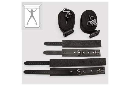 Black leather cuffs and restraint straps