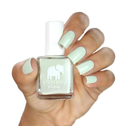 Creamy light green polish swatched with bottle