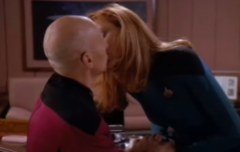 Patrick Stewart as Jean-Luc Picard shares a kiss with Gates McFadden as Beverly Crusher on Star Trek The Next Generation