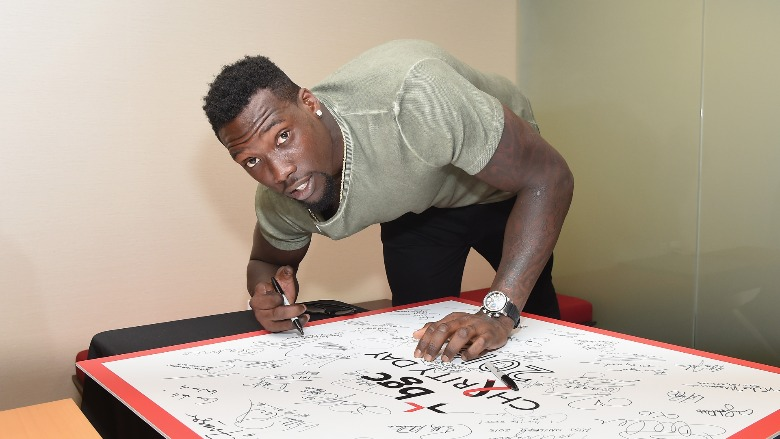 Jason Pierre-Paul signing an autograph.