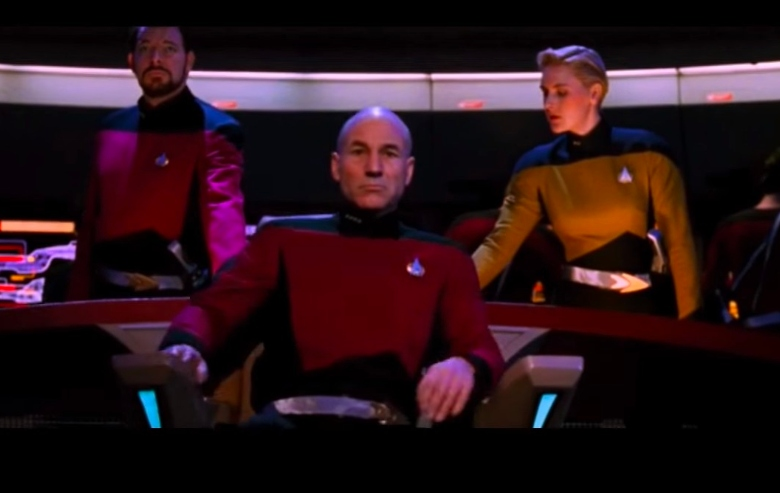 "Jonathan Frakes as Commander Riker, Patrick Stewart as Captain Picard, and Denise Crosby as Lt. Tasha Yar in the episode ""Yesterday's Enterprise"""