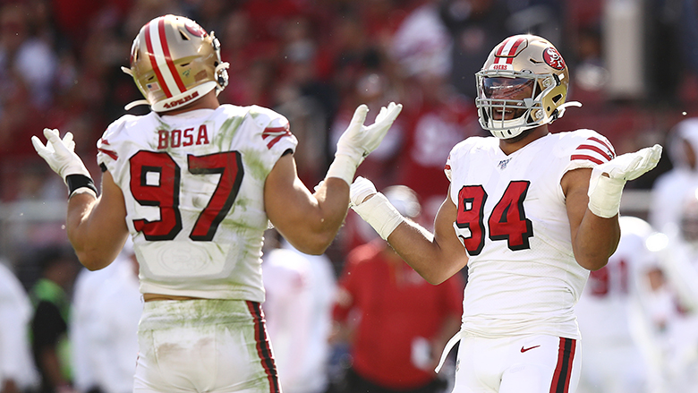 SANTA CLARA, CALIFORNIA - OCTOBER 27: Nick Bosa #97 and Solomon Thomas #94 of the San Francisco 49ers react after sacking Kyle Allen #7 of the Carolina Panthers (not pictured) during the second quarter at Levi's Stadium on October 27, 2019 in Santa Clara, California. (Photo by Ezra Shaw/Getty Images)