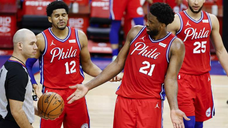 Joel Embiid nudges refs into calling a technical foul.