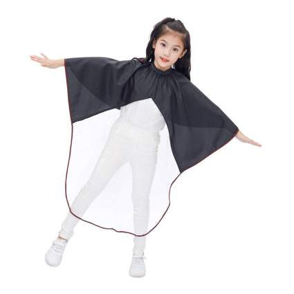 Child in see through hairdressing cape