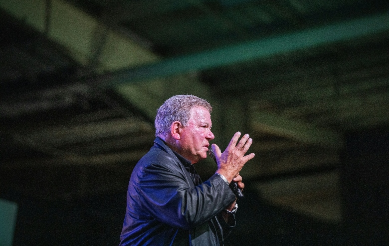 William Shatner speaks from the stage at the second edition of the multi-genre entertainment comic and fan convention 'Comic Con Africa' in Johannesburg on September 21, 2019