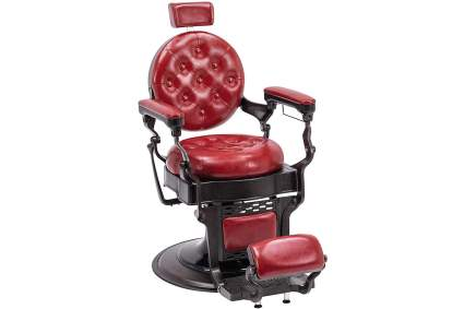 Vintage barber chair in red with dark metal hardware