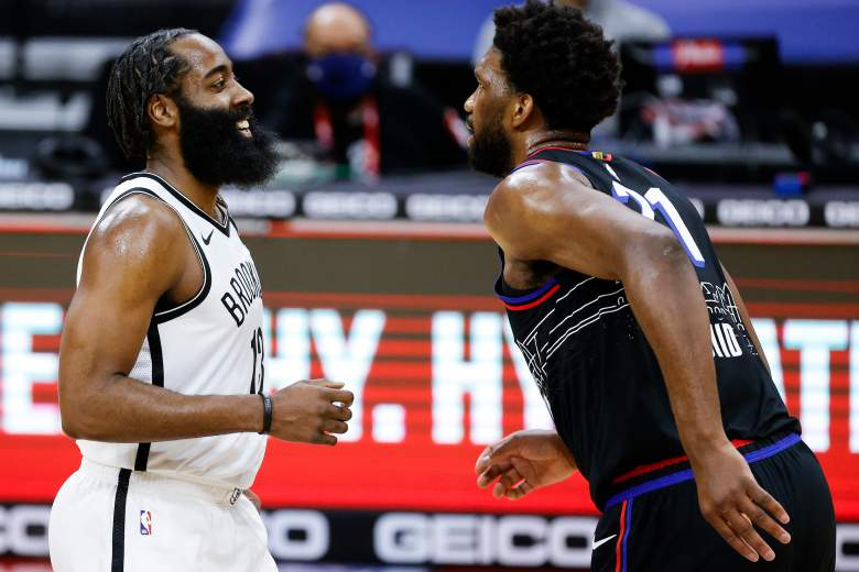 The Sixers' Joel Embiid, right, and Nets star James Harden
