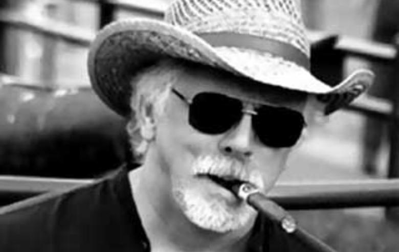 Head shot of J.G. Hertzler smoking a cigar