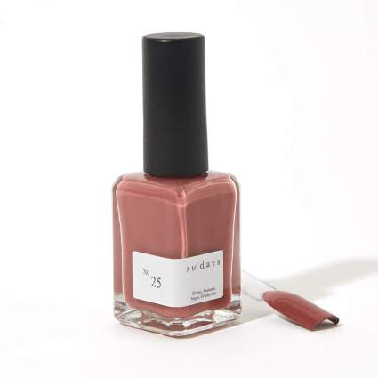 Clay red nail polish bottle and swatch stick