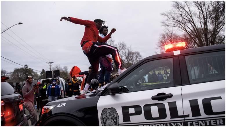 people jump on squad cars