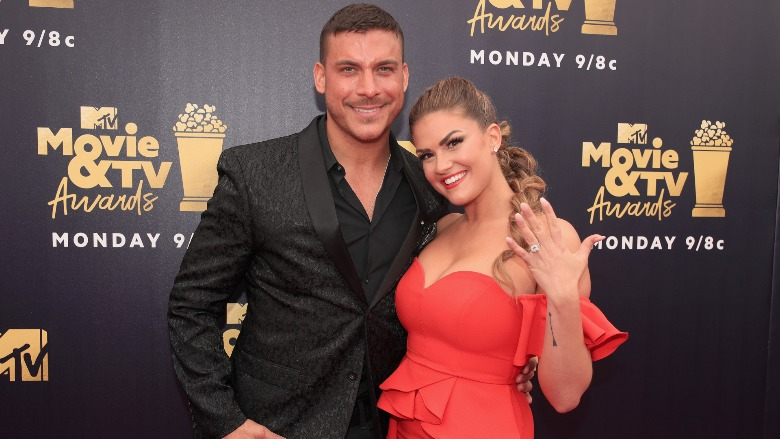 Jax Taylor and Brittany Cartwright pose for photos.