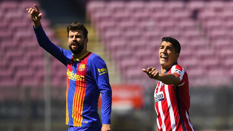 GGerard Pique and Luis Suarez