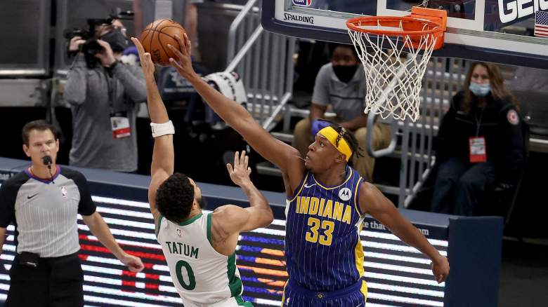 Myles Turner, right, blocks an attempt by Jayson Tatum of the Boston Celtics.