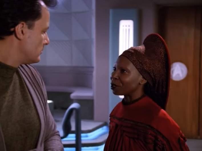 "John de Lancie as Q and Whoopi Goldberg as Guinan in ""Star Trek: The Next Generation"""