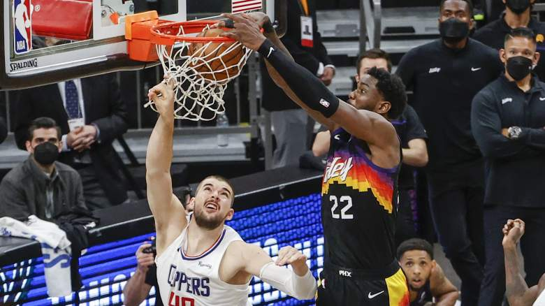 DeAndre Ayton of the Suns dunks over the Clippers' Ivica Zubac