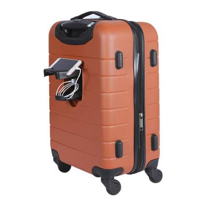 Burnt orange carry one luggage with phone charger