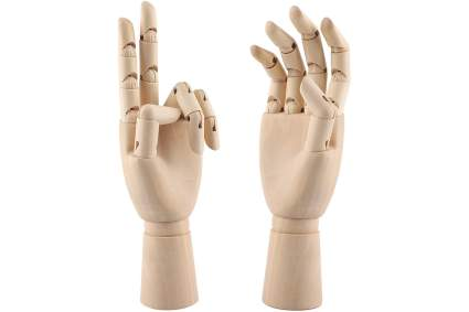 Two wooden poseable hands