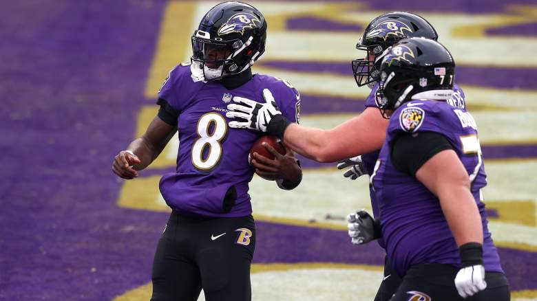 Ravens G Ben Powers celebrates with QB Lamar Jackson