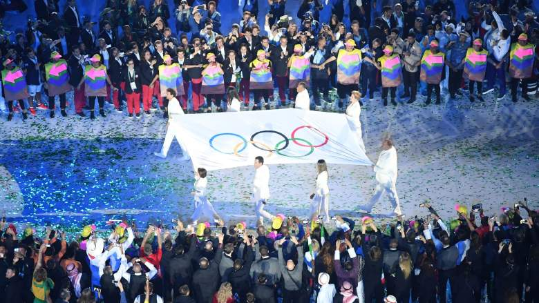 The Olympic flag is carried before being raised during the opening ceremony of the Rio 2016 Olympic Games