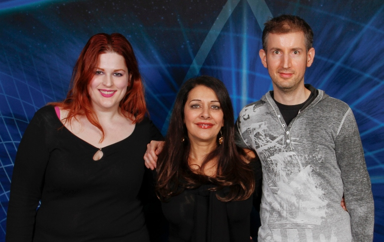 Marina Sirtis poses with fans at a convention