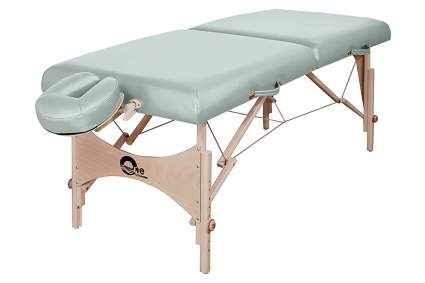 Sage green massage and treatment table