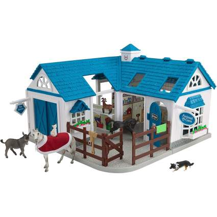 Blue play stable for toy horses