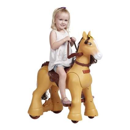 Toddler riding tan plastic horse