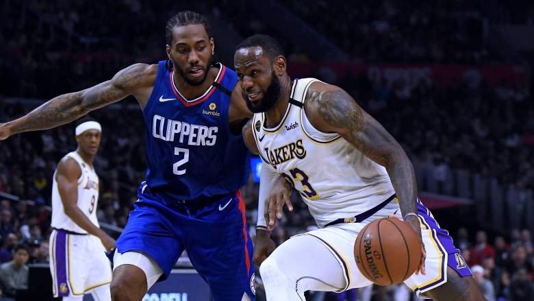 Clippers forward Kawhi Leonard (left) and LeBron James of the Lakers