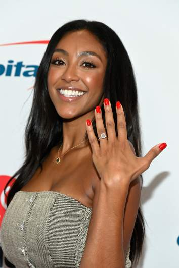 Tayshia Adams shows off her engagement ring.