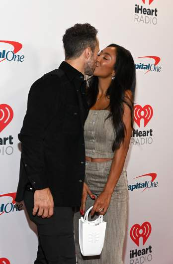 Zac Clark and Tayshia Adams kiss.