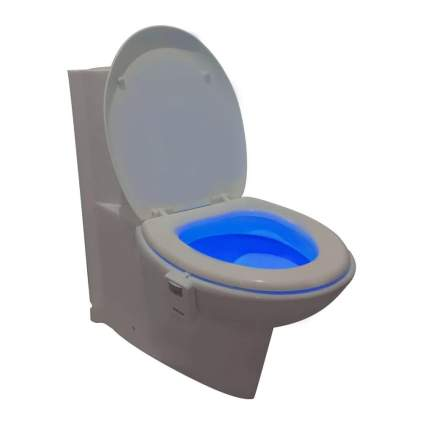 Toilet with glowing blue bowl