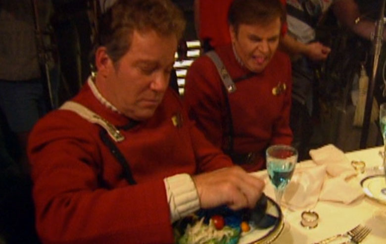 Notice the look of disgust on the face of Walter Koenig as Shatner fiddles with the blue food.