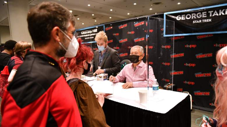 George Takei signs autographs during Day 1 of New York Comic Con 2021 at Jacob Javits Center on October 07, 2021