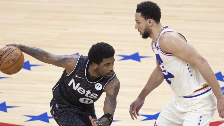 The Nets' Kyrie Irving (left) and Ben Simmons of the Sixers